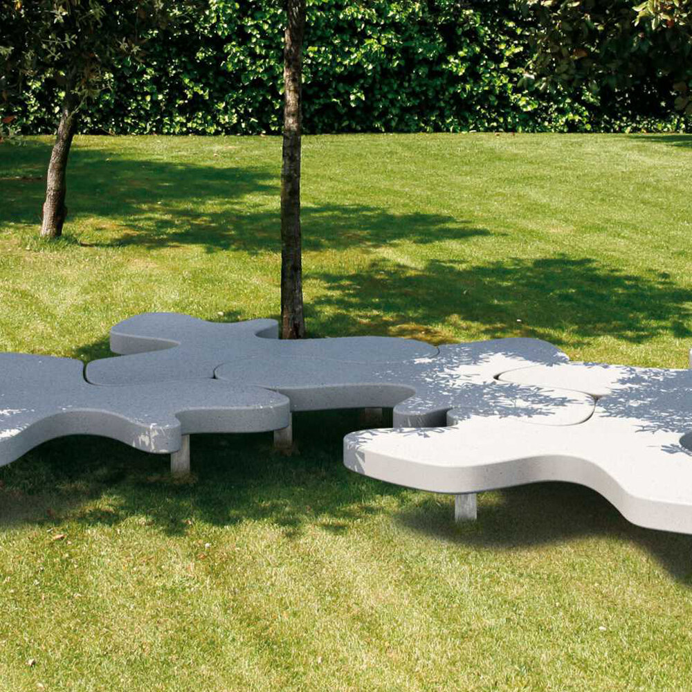 Free standing Natural Puzzle monolithic bench, made from marble or granite and designed by PIO & TITO TOSO