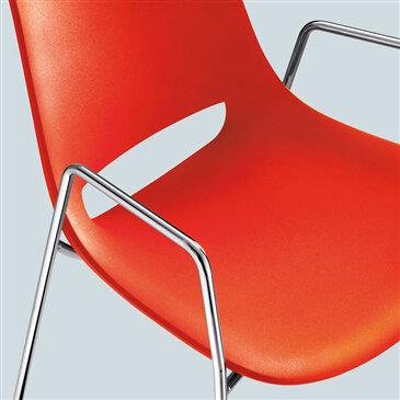 Orange polyethylene Palm Cafe chair, four leg frame with arm rest
