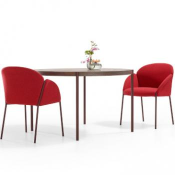 Two red Artifort Andrea chairs around table