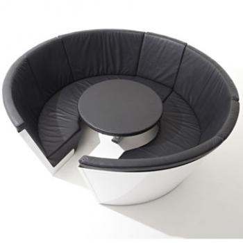 Kosmos seating system in white and black with a table from Extremis
