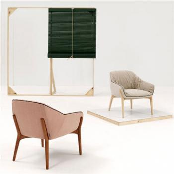 Hand-crafted ash wood Nido armchair, with upholstered seat, back and sides.