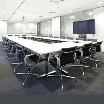 White Vivante 60 20 folding meeting table surrounded by black chairs