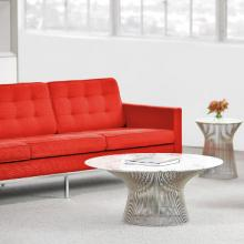 Red Florence Knoll sofa with a coffee table
