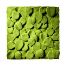 Wall-mounted sound absorber in the shape of leaves in the colour green