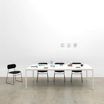 White Edge meeting table with 4 black chairs