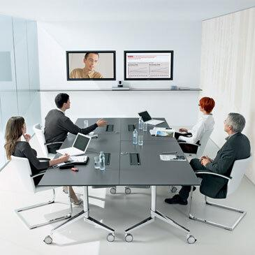 Grey Flex Flip Top Table in a white meeting room