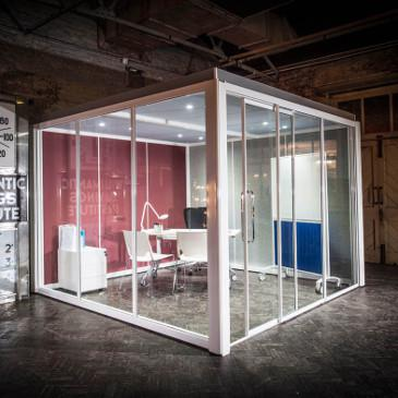 Glazed square meeting pod with 2 acoustic walls