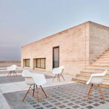 Eames plastic armchairs in white on rooftop