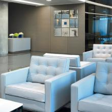 White Florence knoll armchairs in a waiting area