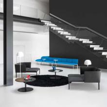 Black and white room with blue seating system