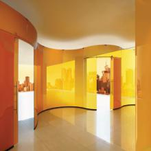 Freestanding orange glass wall, created by Casali.