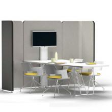 Lets meet presentation space with grey upholstery and white tables and chairs