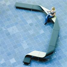 Green Flip and Fold bench on a blue tiled floor