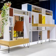 Lande Fundamentals storage solution with blue, orange, yellow fabric panels and multiple shelves