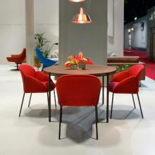 Red Artifort Andrea chair around table