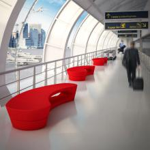 Red Boomerang benches at airport