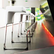 A line of white Fizz Barstools